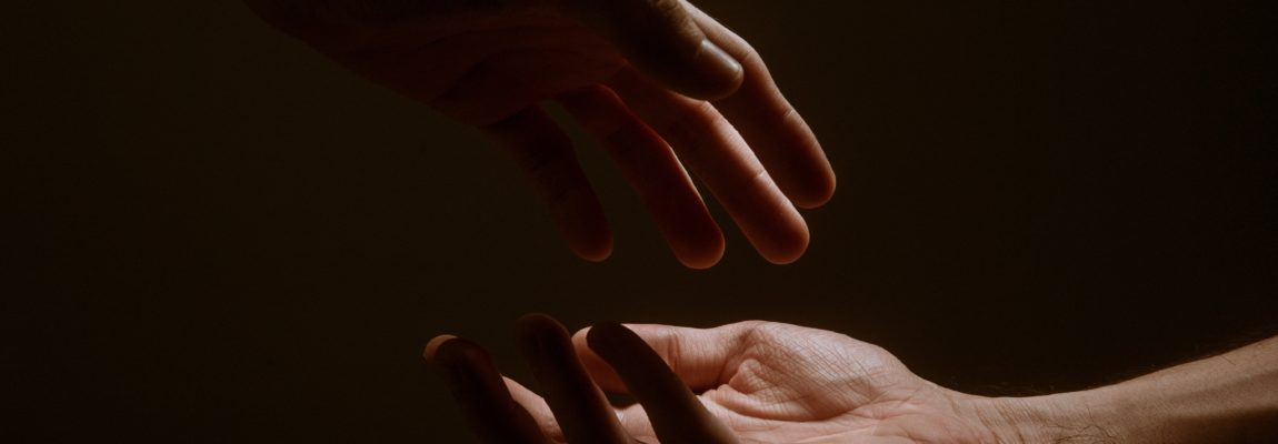 Two hands about to reach each other