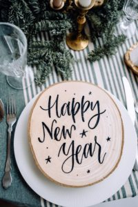 Wooden block with Happy New Year engraved